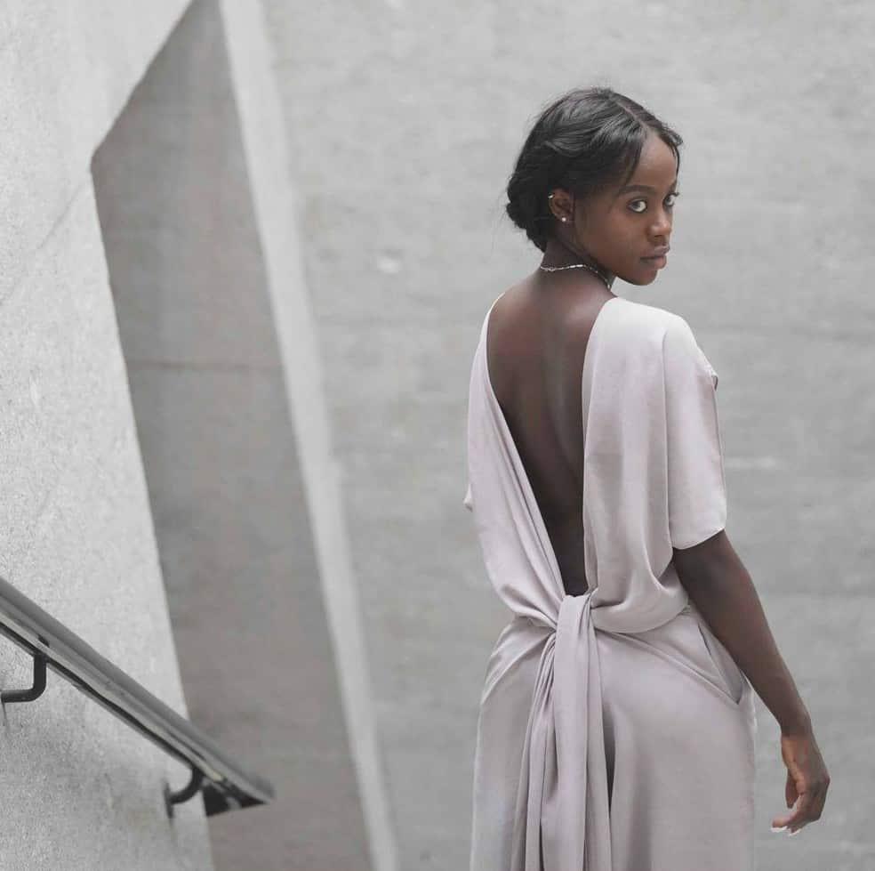Model wearing grey dress
