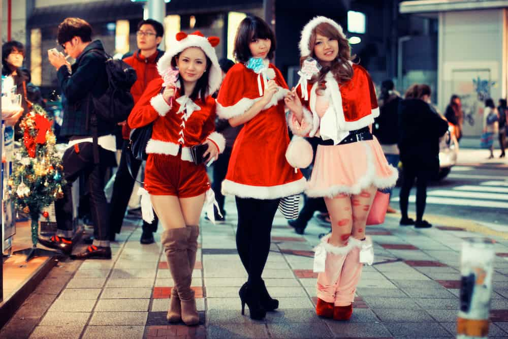 three girls in santa outfits
