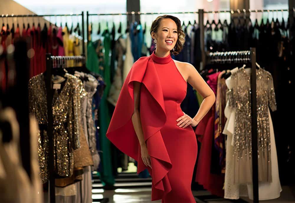 Model wearing red Covetella dress rental
