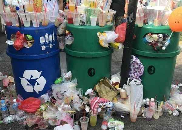 Overflowing recycling bins in Singapore