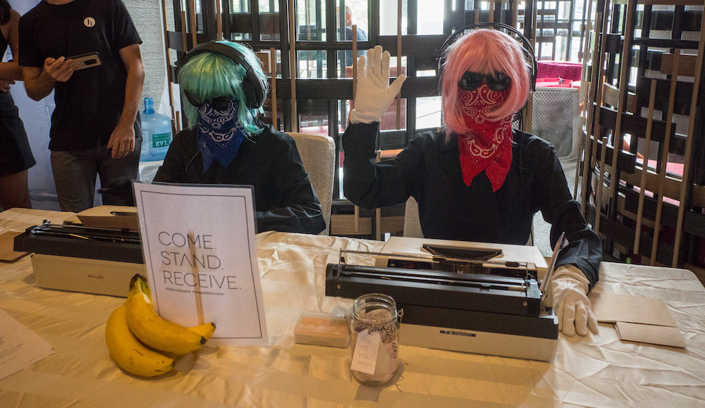 two people in wigs with typewriters