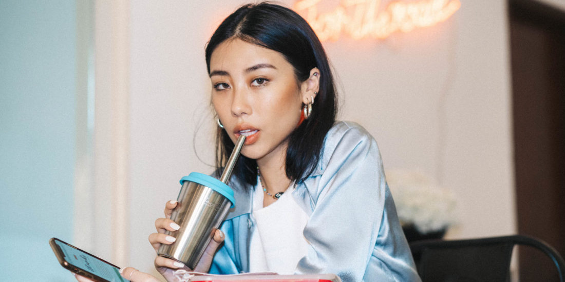 Girl drinking from reusable cup