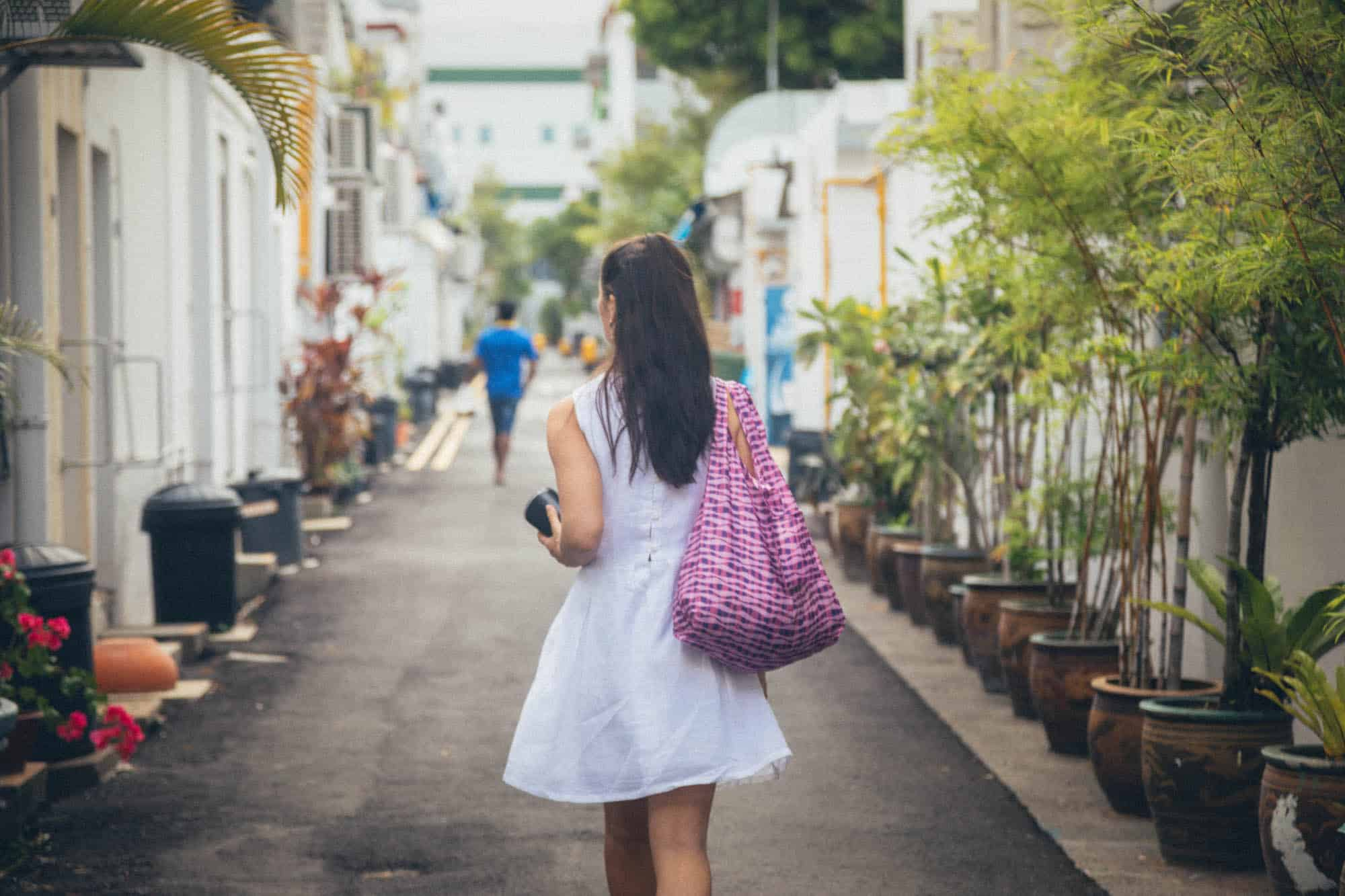 Girl carrying a Peco bag