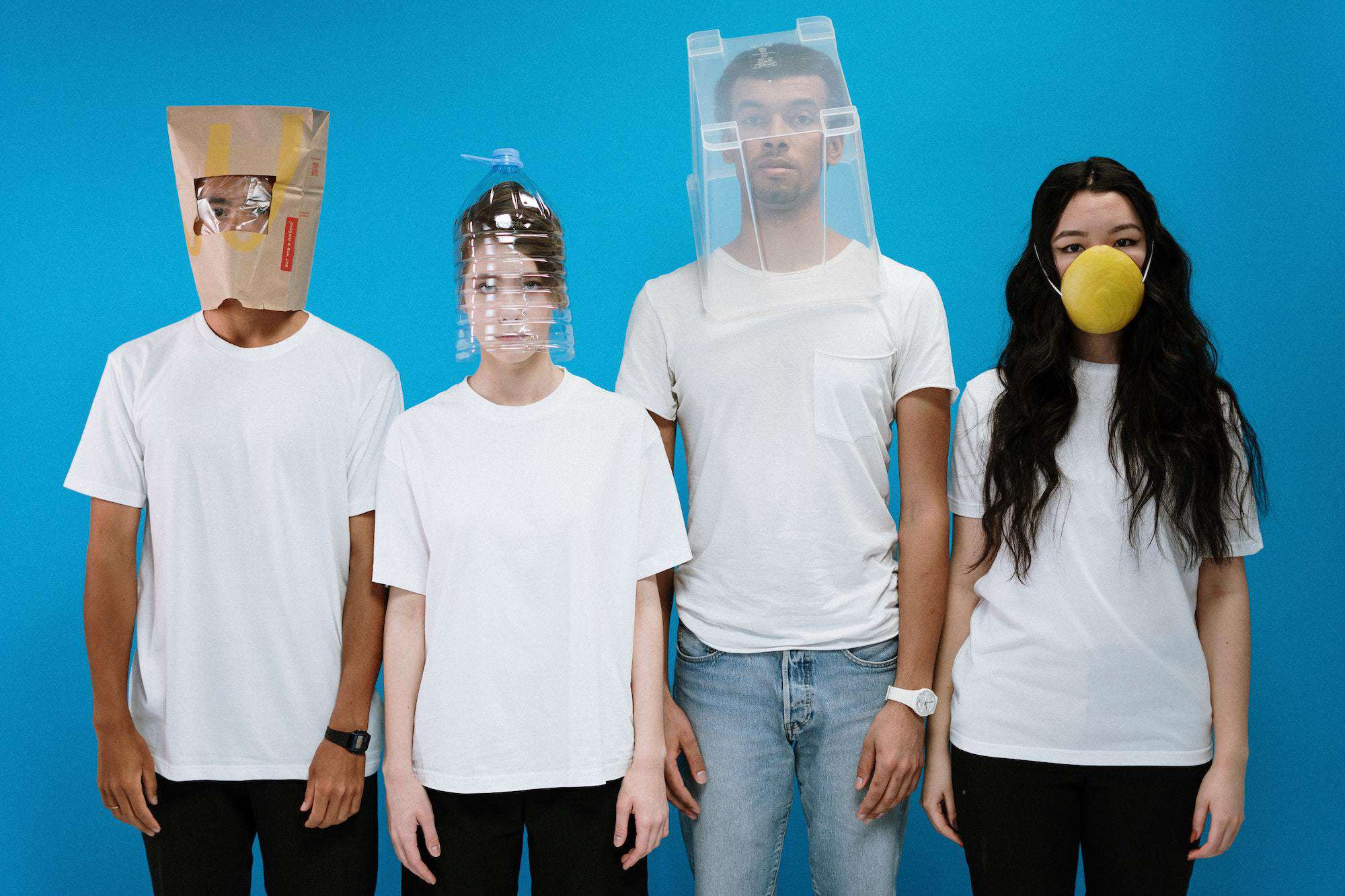 Four people wearing face masks