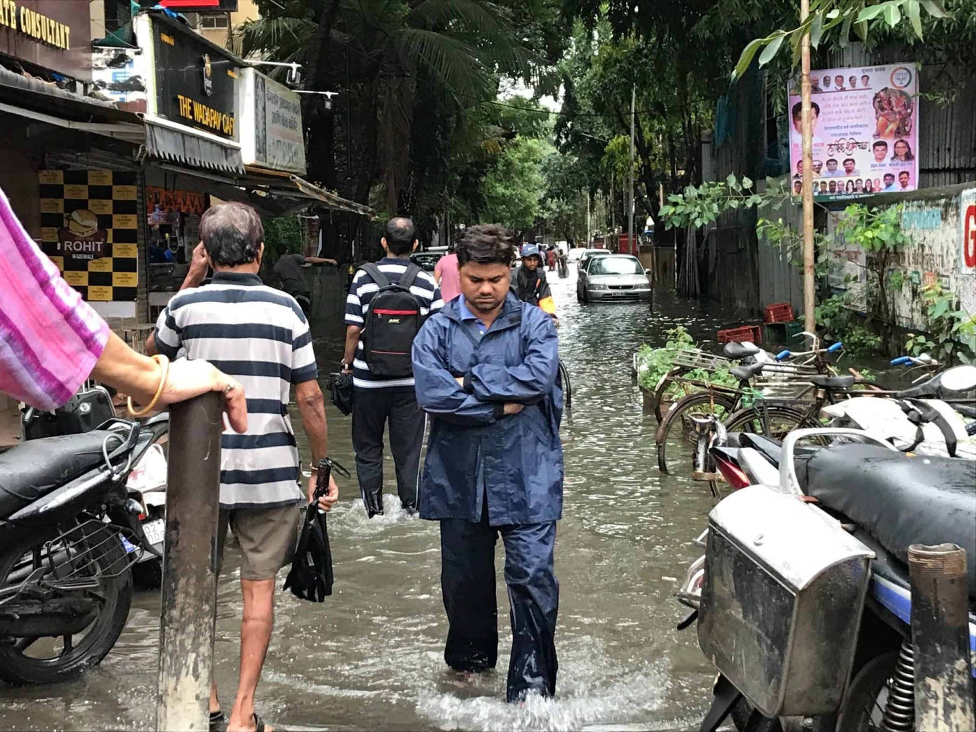 Human cost of disaster: Man in flooded area